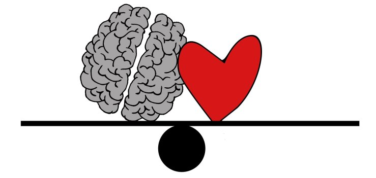 brain next to a heart balanced perfectly on a seesaw